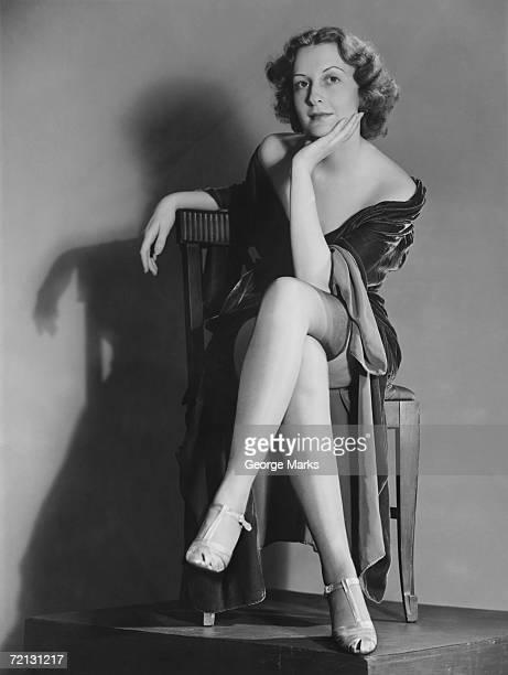Woman posing in lingerie (B&W), portrait