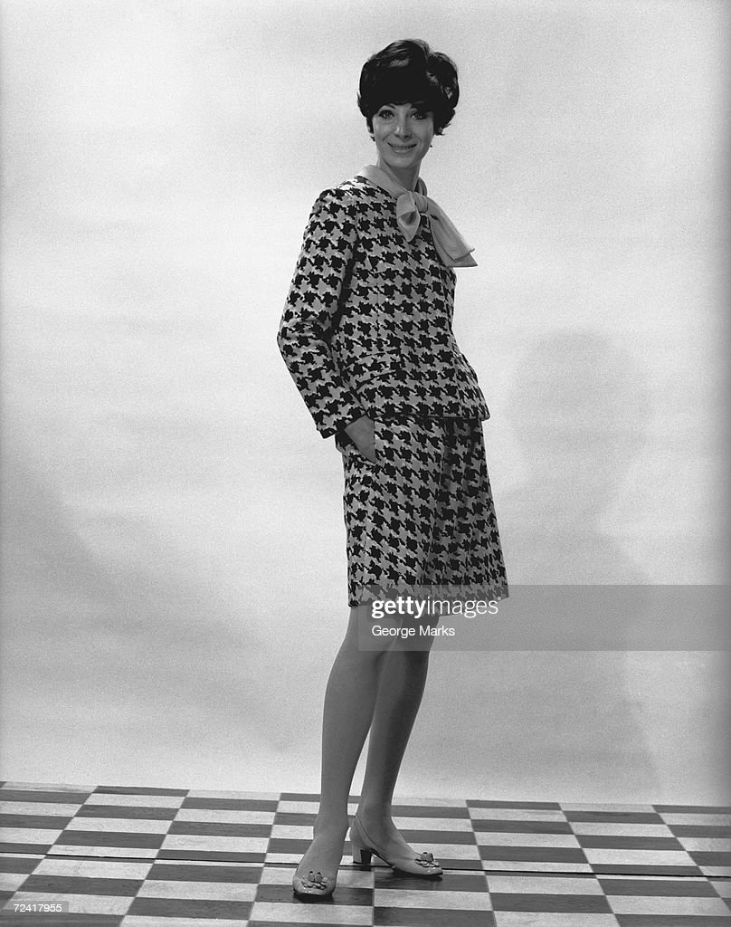 Woman posing in studio, (B&W),, portrait