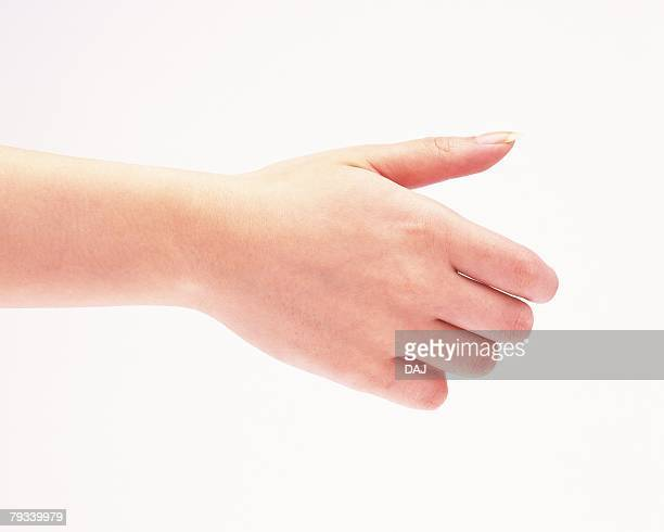 Woman posing of shaking hand