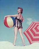 Woman Posing on Beach Holding Colorful Beach Ball