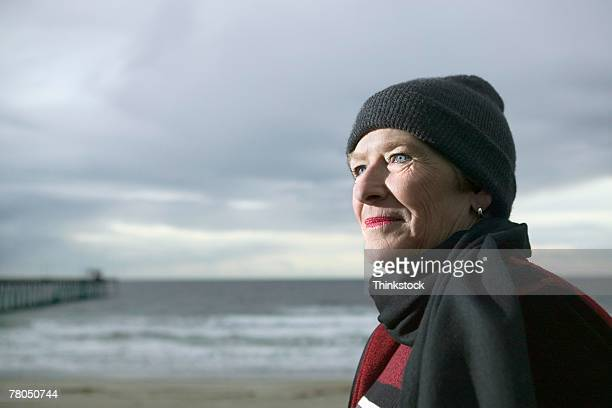 Woman posing on beach in stocking cap