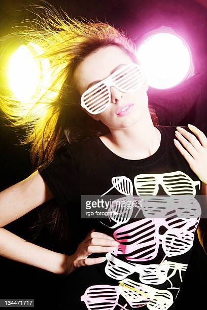 Woman, 24, posing with a cool pair of glasses and a t-shirt
