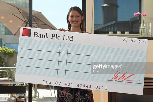 Woman posing with an oversized blank cheque