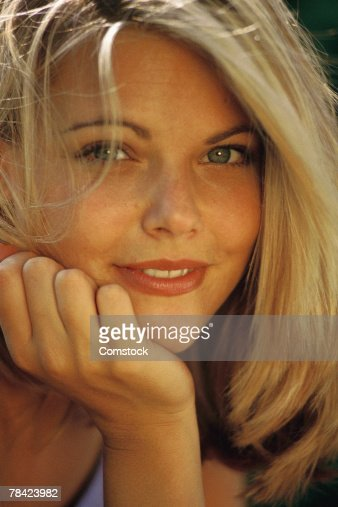 Woman posing with chin in hand : Stock Photo