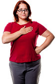 Woman Posing With Hand Over Heart