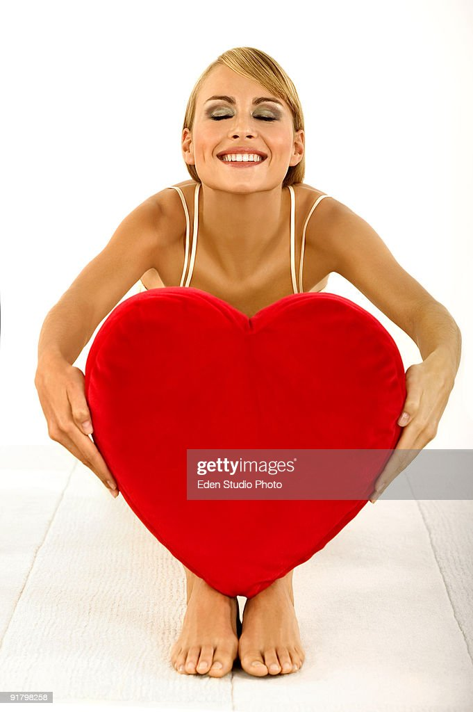 Woman posing with heart : Stock Photo