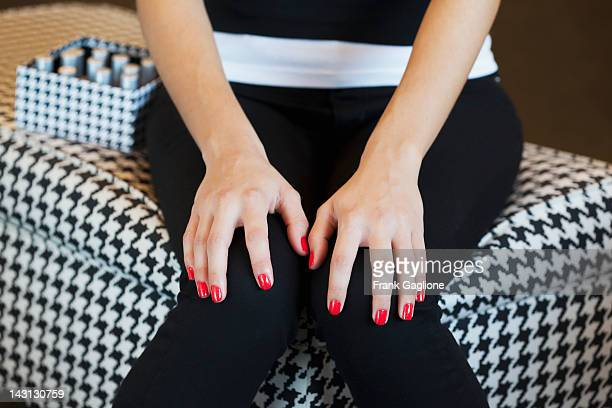 Woman posing with painted nails.