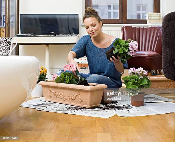 Woman potting balcony plants