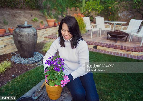 Woman Potting Flowers