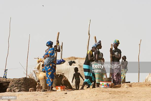 Woman pounding millet in a village along the shores of the Niger River between Mopti and Lake Debo Mali