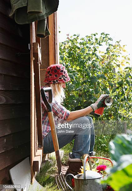 woman pouring drink in allotment
