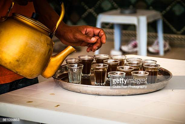 Woman pouring mint tea in Tunisia
