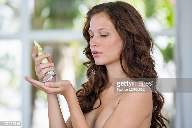 Woman pouring moisturizer on hand