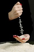 Woman pouring rice into cupped hands