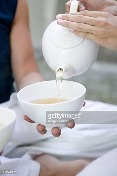 Woman pouring tea