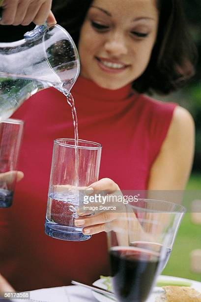 Woman pouring water
