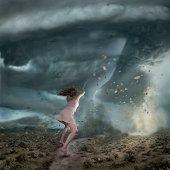 Woman in front of huge Tornado