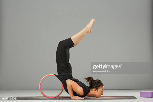 Woman practicing advanced yoga  Fitness Stretching training  Yoga wheel poses