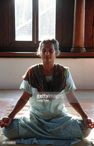 A woman practicing meditation an ancient Indian method of controlling the mind through creative visualisation and breathing techniques Meditation its...