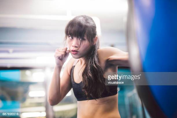 Woman Practicing on a Punching Bag