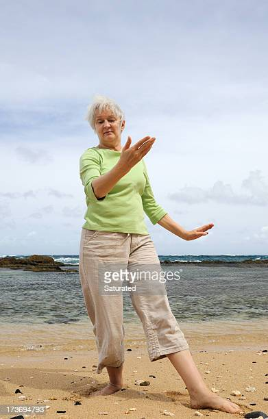Woman Practicing Tai Chi on the Beach