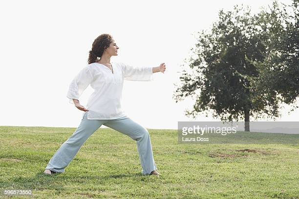 Woman practicing tai chi