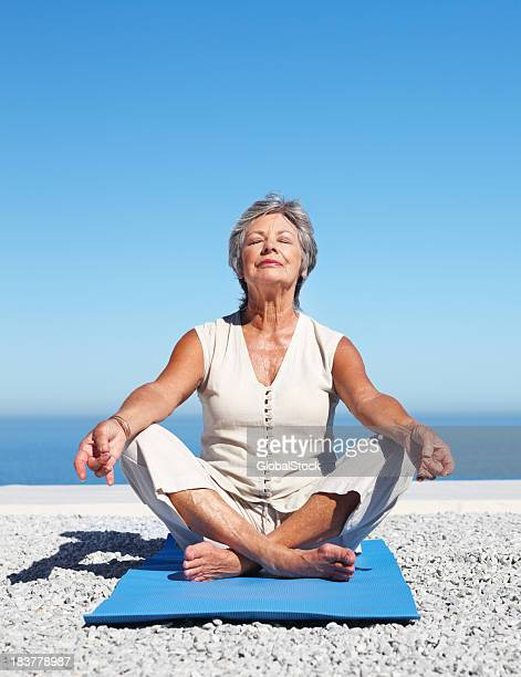 Woman practicing yoga against sky