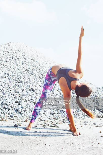 Woman practicing yoga at a construction site