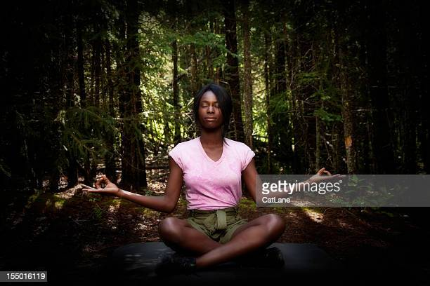 Woman Practicing Yoga in Nature