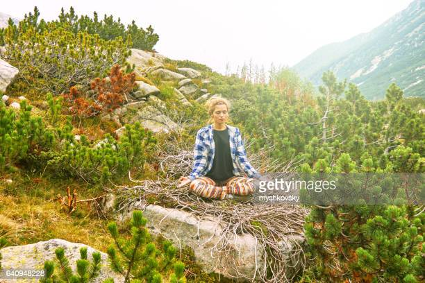 Woman practicing yoga in the Rila mountains
