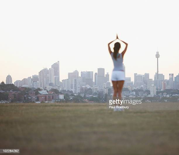 Woman practicing yoga in urban park