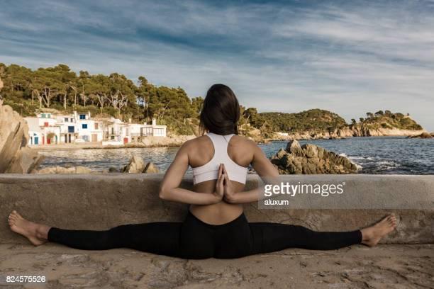 Woman practicing yoga pose with reverse namaste