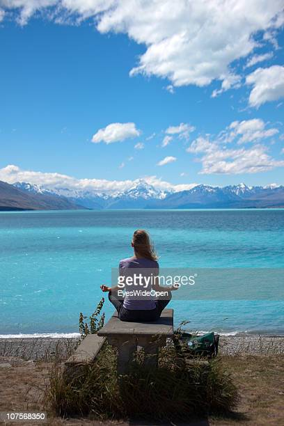 Woman practising Yoga at Lake Pukaki with an outlook at MtCook on December 12 2010 in Aoraki / Mount Cook National Park South Island New Zealand Mt...