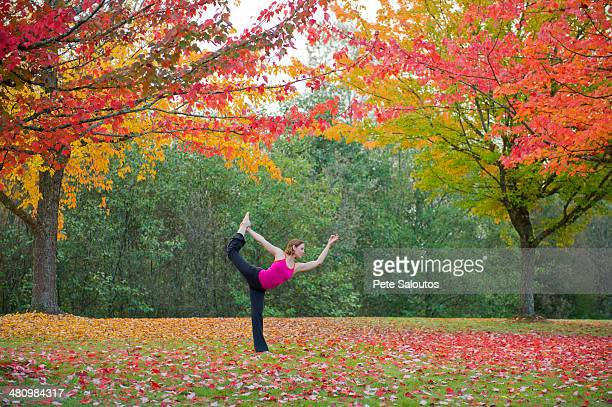 Woman practising yoga in forest
