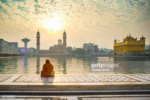 Woman pray at Golden temple