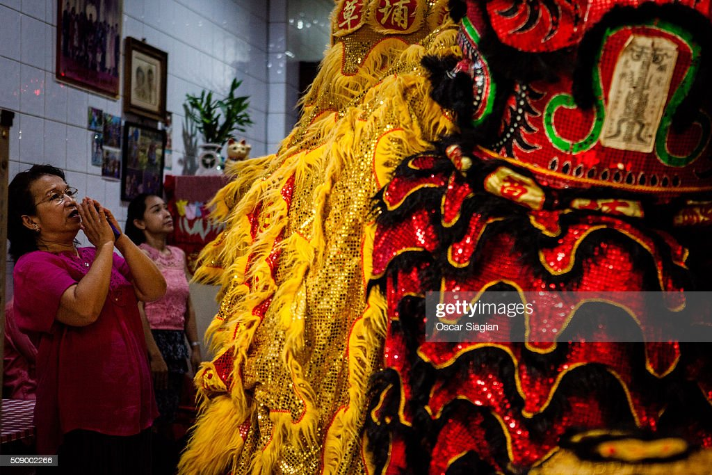 A woman pray to the dragon dancer that go inside her house at Glodok district on February 8, 2016 in Jakarta, Indonesia. The Chinese Lunar New Year also known as the Spring Festival, which is based on the Lunisolar Chinese calendar, is celebrated from the first day of the first month of the lunar year and ends with Lantern Festival on the fifteenth day.