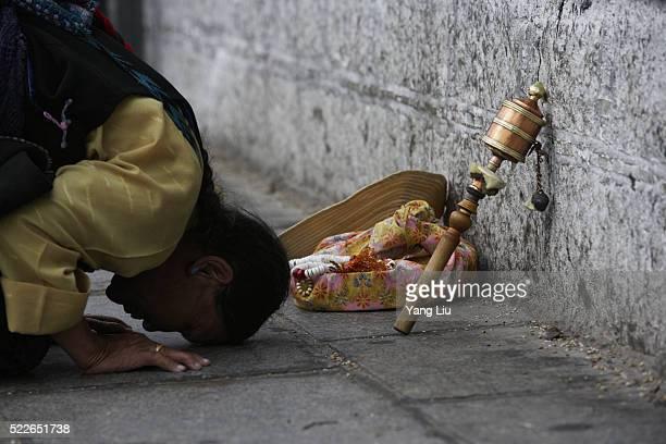 Woman Praying at Jokhang Temple