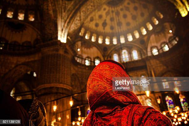 Woman praying inside a mosque