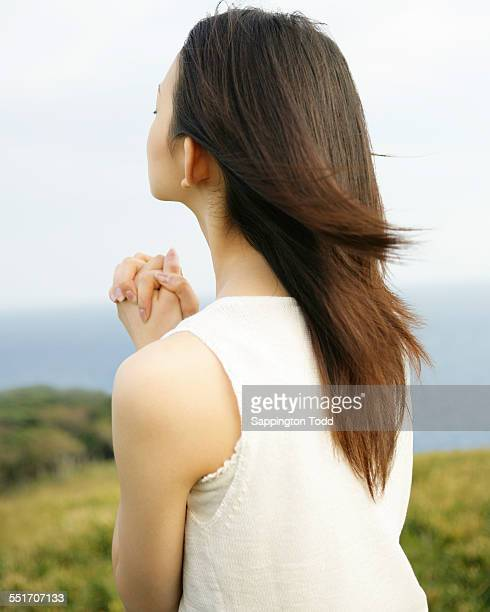 Woman Praying With Her Hands Folded