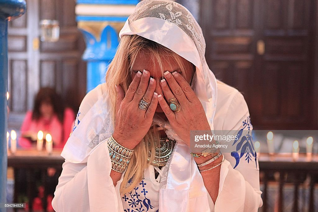 A woman prays as Jews from different countries visit Synagogue La ghriba to celebrate Lag BaOmer in Djerba, Tunisia on May 25, 2016.