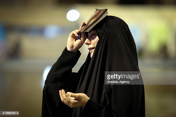 A woman prays at Mosalla Mosque on the 19th day of Ramadan as eventual Laylat alQadr One of the Muslim's holiest nights in Tehran Iran on July 08...