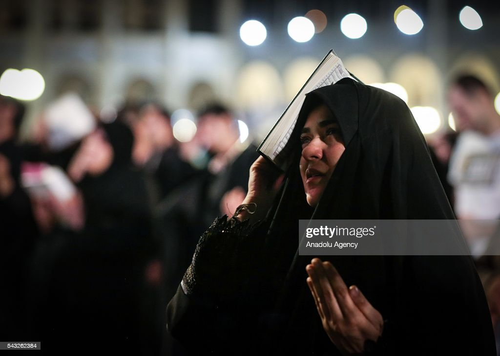 A woman prays at Mosalla Mosque on the 21th day of Ramadan as eventual Laylat al-Qadr (Night of Power), One of the Muslim's holiest nights, in Tehran, Iran on June 27, 2016. Iranian people assume that 19th, 21st and 23rd days of Ramadan are probable Laylat al-Qadr night and named as Shab-i Ihya. They gather in mosques on these three nights and pray until the morning.