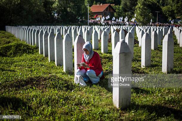A woman prays at the Potocari cemetery and memorial near Srebrenica on July 10 2015 in Srebrenica Bosnia and Herzegovina The newlyidentified remains...