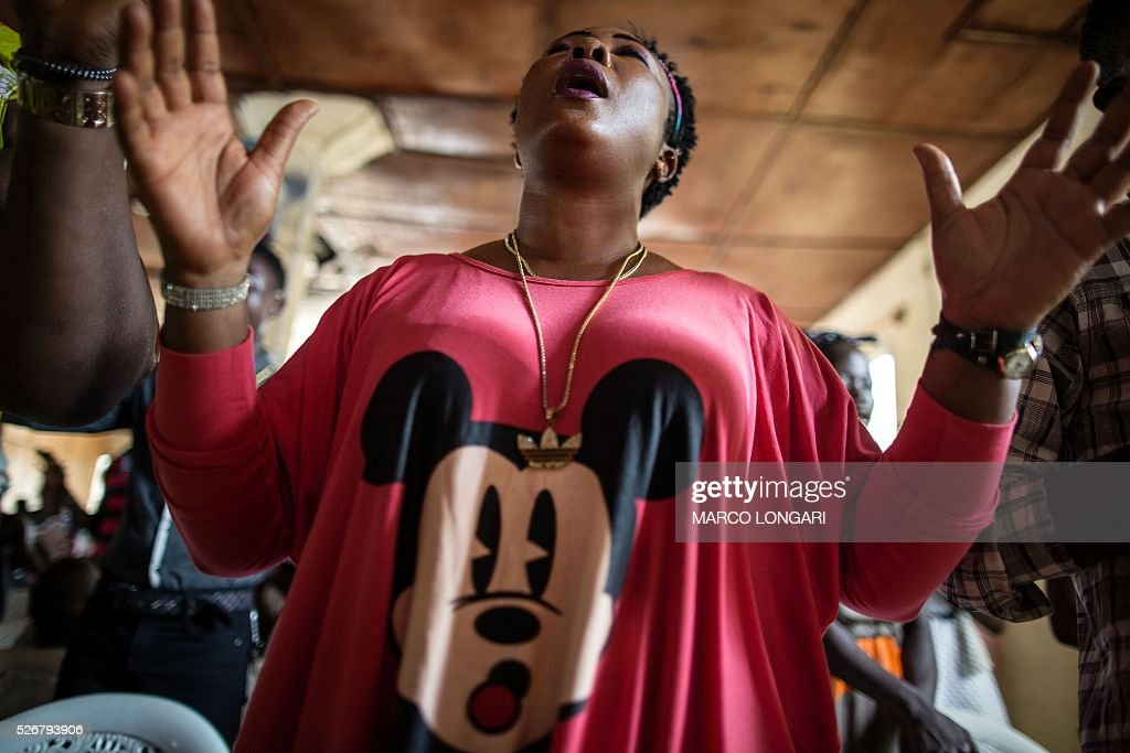 A woman prays at the Winners Chapel International in the Weasay district of Monrovia on May 1, 2016. / AFP / MARCO