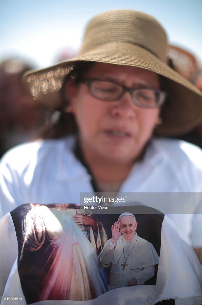 A woman prays during a mass for the people at Ecatepec on February 14, 2016 in Ecatepec, Mexico. Pope Francis is on a five days visit in Mexico from February 12 to 17 where he is expected to visit five states.