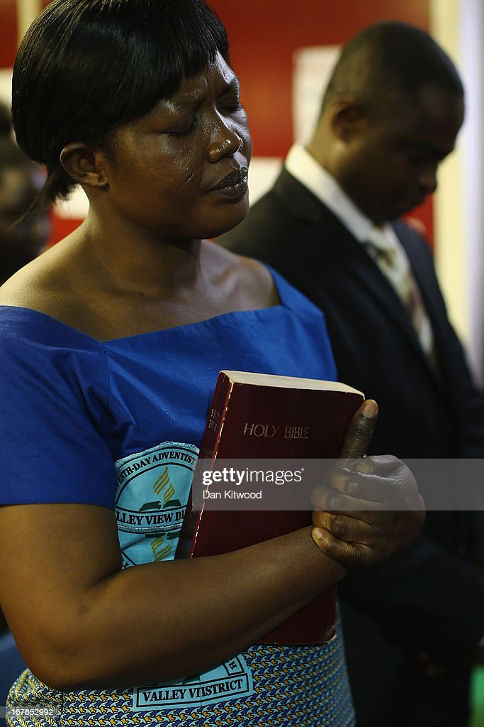 A woman prays during a 'Seventh Day Evangelist' service at Crossway Church in the Heygate Estate on April 27, 2013 in London, England. The Crossway Church is an international church, with the congregation made up of native Londoners as well as people from Ghana, Jamaica, South Africa, Zimbabwe, Korea, Brazil, Eastern Europe and the United States. It has been serving the local community at different sites around Elephant and Castle for almost 150 years. The church has been at it's current location in the Heygate estate since 1974. The Heygate estate in central London was built in 1974 as social housing and housed around 3000 people, but fell into a state of disrepair, gaining a reputation for crime and poverty. The estate is due to be demolished as part of the £1.5billion GBP 'Elephant & Castle regeneration scheme', and replaced with 2,500 affordable new homes. The area has become popular with street artists, storytellers, and guerilla gardeners and attracts an array of urban wildlife including bats, birds and mammals.