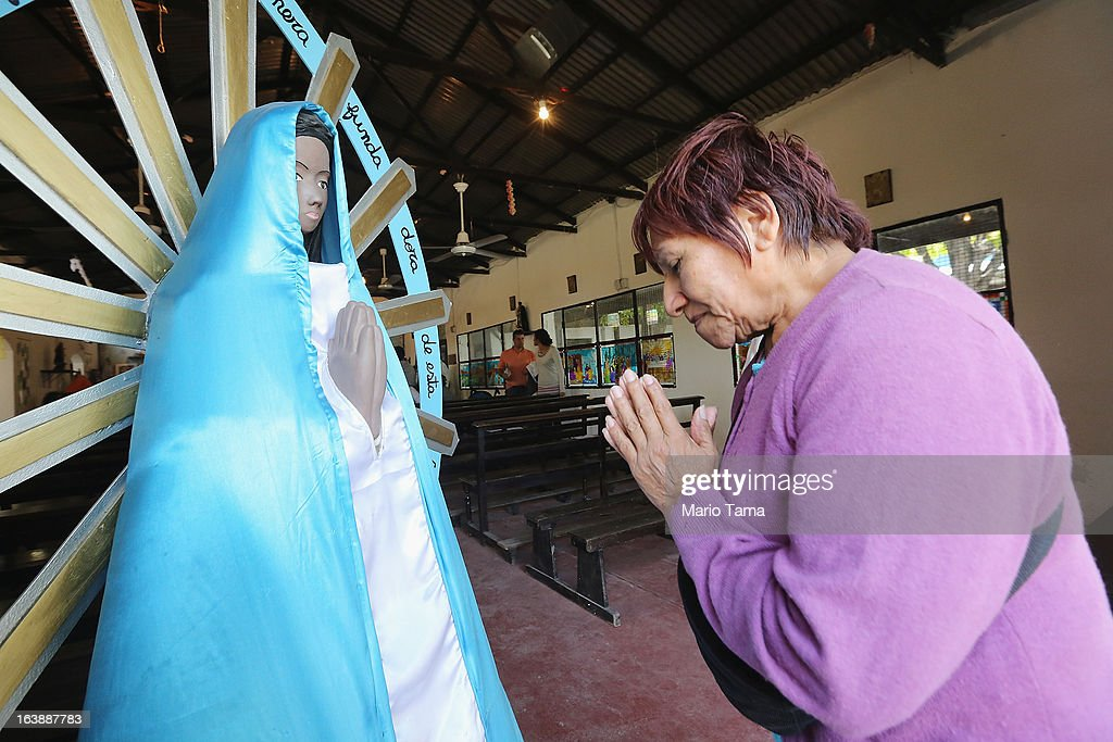 A woman prays following Sunday Mass at the Santa Maria Madre del Pueblo church, in the Villa 11/01/14, where archbishop Jorge Mario Bergoglio, now Pope Francis, used to perform charity work, on March 17, 2013 in Buenos Aires, Argentina. Francis was the archbishop of Buenos Aires and is the first Pope to hail from South America. Some locals are now affectionately calling Francis, known for his charity work in the slums, the 'slum pope.'