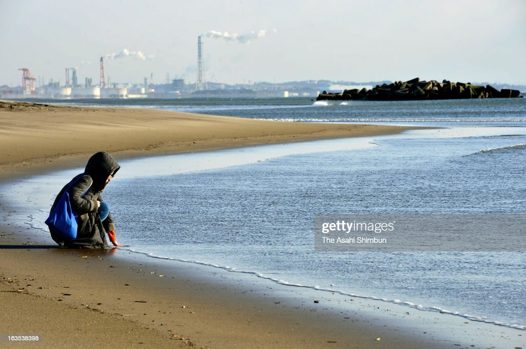 A woman prays for the victims of the Magnitude 9.0 Earthquake and tsunami at Arahama beach on March 11, 2013 in Sendai, Miyagi, Japan. Japan commemorates second anniversary of the Magnitude 9.0 earthquake and subsequent tsunami, that claimed more than 18,000 lives.