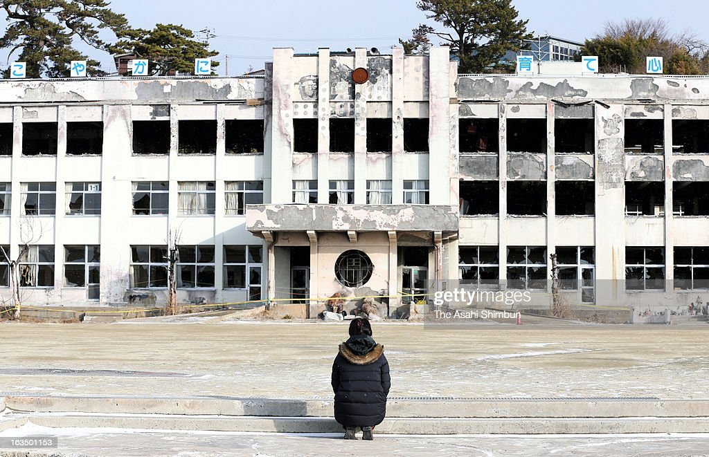 A woman prays for the victims of the tsunami that was triggered by the Magnitude 9.0 earthquake two years ago, at Kadonowaki Elementary School on March 11, 2013 in Ishinomaki, Miyagi, Japan. On March 11, Japan marks second anniversary of the Magnitude 9.0 earthquake and subsequent tsunami, that claimed more than 18,000 lives.