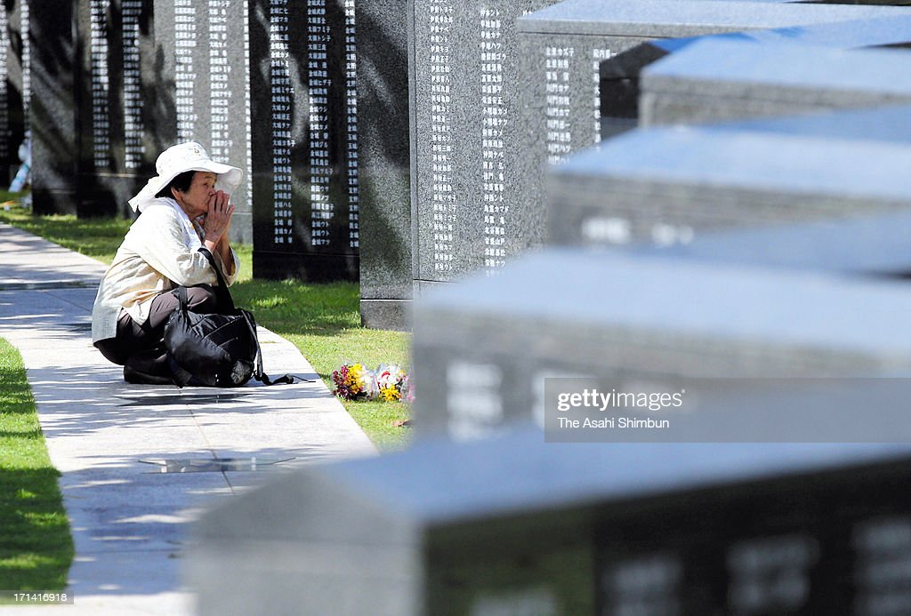 A woman prays for the war dead in front of Heiwa-no-Ishiji or 'Cornerstone of Peace', the memorial to commemorate Okinawa-related war victims, at Okinawa Prefecture Peace Memorial Parkon June 23, 2013 in Itoman, Okinawa, Japan. During the 3-month ground battle at the end of World War II, more than 200,000 people were killed.